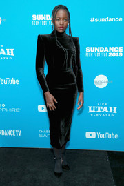 Lupita Nyong'o complemented her dress with black ankle-strap pumps.