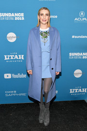 Emma Roberts sealed off her cold-weather ensemble with a pair of gray suede ankle boots, also by Prada.