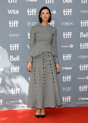 Caitriona Balfe donned a long-sleeve checkered peplum top for the 'Ford v Ferrari' press conference during the 2019 Toronto International Film Festival.