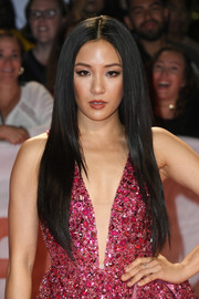 Constance Wu wore her long hair down in a sleek straight style at the TIFF premiere of 'Hustlers.'