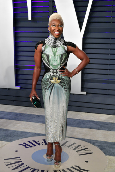 Cynthia Erivo sealed off her look with silver platform sandals by Jimmy Choo.