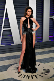 Kendall Jenner was one breath away from a wardrobe malfunction in a black Rami Kadi Couture gown with a keyhole cutout and a barely-there skirt at the 2019 Vanity Fair Oscar party.