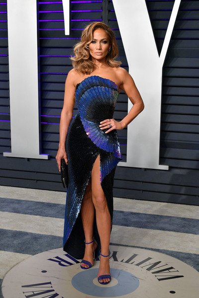 Jennifer Lopez went for modern glamour in an iridescent strapless gown by Zuhair Murad Couture at the 2019 Vanity Fair Oscar party.