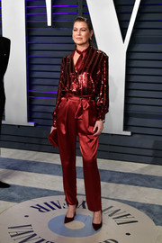 Ellen Pompeo matched her outfit with a pair of red velvet pumps.