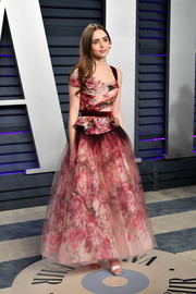 Lily Collins looked dreamy in a floral ballgown by Marchesa at the 2019 Vanity Fair Oscar party.
