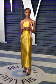 Letitia Wright looked darling in a yellow off-the-shoulder dress with pink bow detailing at the 2019 Vanity Fair Oscar party.