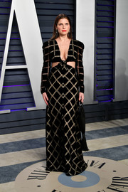Lake Bell was modern and chic in a grid-patterned cutout gown by Markarian at the 2019 Vanity Fair Oscar party.