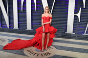 Chiara Ferragni made a grand entrance in an off-the-shoulder red Giambattista Valli Couture dress with a flowing train at the 2019 Vanity Fair Oscar party.