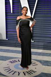 Jennifer Hudson chose a black cold-shoulder gown with silver fringe beading for the 2019 Vanity Fair Oscar party.