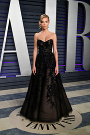 Josephine Skriver looked perfectly elegant in a strapless black ballgown by Anne Barge at the 2019 Vanity Fair Oscar party.