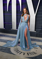 Alessandra Ambrosio looked ravishing in a beaded blue Zuhair Murad gown with a cleavage-baring neckline and a hip-high slit at the 2019 Vanity Fair Oscar party.