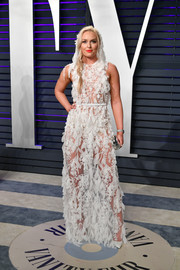Lindsey Vonn turned heads in a sheer appliquéd gown by Daalarna Couture at the 2019 Vanity Fair Oscar party.