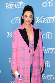 Kacey Musgraves paired a white acrylic clutch by Edie Parker with a pink plaid coat for the 2019 Variety Hitmakers Brunch.