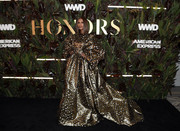 Iman made a grand entrance in a gold leopard-print gown by Valentino Couture at the 2019 WWD Honors.