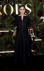 Olivia Palermo looked charming in a black gown with floral-embroidered sleeves at the 2019 WWD Honors.