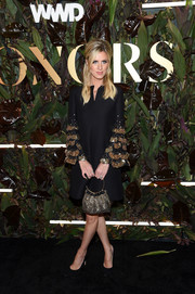 Nicky Hilton coordinated her dress with a gold purse.