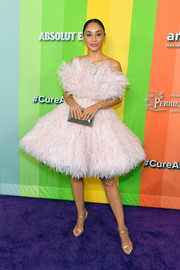 For her bag, Cara Santana chose a faceted silver clutch by Judith Leiber.