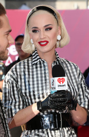 Katy Perry paired an oversized black patent belt with a gingham shirtdress for the 2019 iHeartRadio Music Awards.