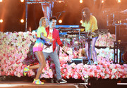 Taylor Swift performed at the 2019 iHeartRadio Wango Tango wearing a pair of rainbow-hued sneakers by Stella McCartney.