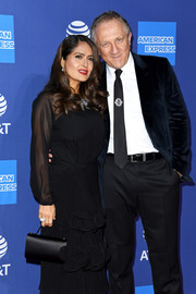 Salma Hayek paired a black satin purse with a ruffled dress for the 2020 Palm Springs International Film Festival Awards.