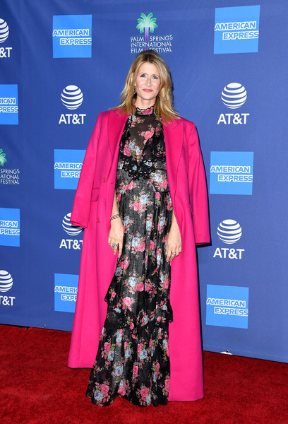 Laura Dern arrived for the 2020 Palm Springs International Film Festival Awards wearing a floor-length fuchsia coat by Raf Simons.