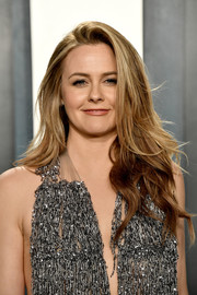 Alicia Silverstone wore her hair in a long layered cut at the 2020 Vanity Fair Oscar party.
