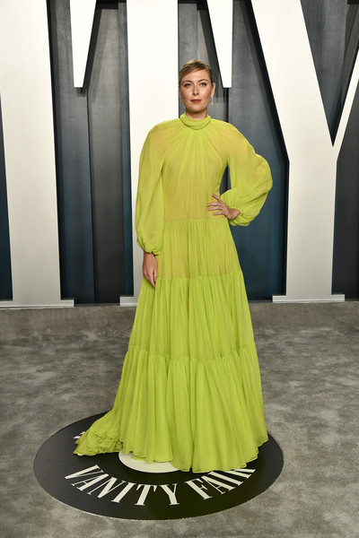 Maria Sharapova brightened up the Vanity Fair Oscar party with her neon-green Valentino gown.