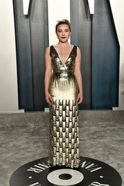 Florence Pugh glowed in a gold sequined gown by Louis Vuitton at the 2020 Vanity Fair Oscar party.