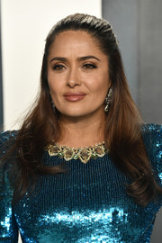 Salma Hayek looked lovely wearing this half-up hairstyle at the 2020 Vanity Fair Oscar party.
