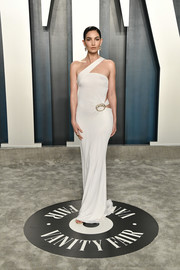 Lily Aldridge looked alluring in a clingy white cutout gown by Gucci at the 2020 Vanity Fair Oscar party.
