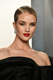Rosie Huntington-Whiteley wore her hair in a side-parted bun at the 2020 Vanity Fair Oscar party.