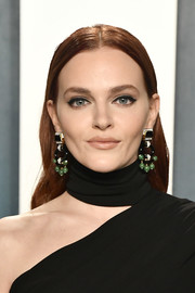 Madeline Brewer attended the 2020 Vanity Fair Oscar party wearing a long center-parted hairstyle.