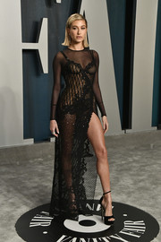Hailey Bieber commanded stares in a sheer black lace gown by Atelier Versace at the 2020 Vanity Fair Oscar party.