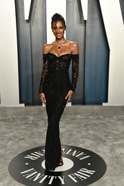 Jasmine Tookes sheathed her supermodel figure in a fitted black off-the-shoulder gown by Georges Hobeika for the 2020 Vanity Fair Oscar party.