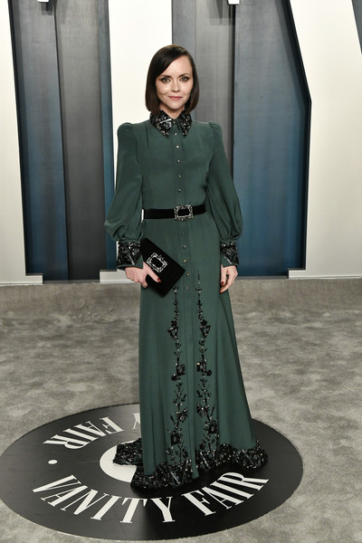 Christina Ricci paired her frock with a crystal-embellished velvet clutch.