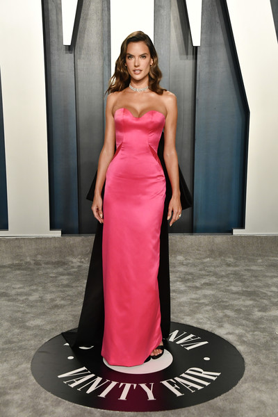 Alessandra Ambrosio channeled Old Hollywood in a strapless hot-pink gown with a contrast train at the 2020 Vanity Fair Oscar party.