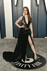 Madelaine Petsch paired her dress with gold platform sandals by Jimmy Choo.