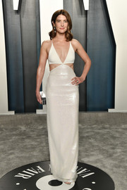 Cobie Smulders flashed her toned physique in a skimpy white cutout gown by David Koma at the 2020 Vanity Fair Oscar party.