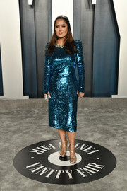 Salma Hayek went for high shine in an electric-blue sequined dress by Gucci at the 2020 Vanity Fair Oscar party.