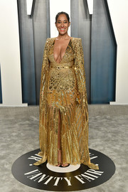 Tracee Ellis Ross went full-on glam in a beaded and caped gold gown by Zuhair Murad Couture at the 2020 Vanity Fair Oscar party.