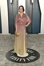 Megan Mullally paired her dress with a textured gold clutch.