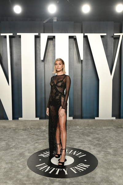 More Pics of Hailey Bieber Sheer Dress (6 of 9) - Hailey Bieber Lookbook - StyleBistro [fashion,beauty,leg,dress,architecture,automotive design,design,fashion model,fashion design,photography,radhika jones - arrivals,radhika jones,hailey bieber,beverly hills,california,wallis annenberg center for the performing arts,oscar party,vanity fair,radhika jones,wallis annenberg center for the performing arts,vanity fair,oscar party,academy awards,party,celebrity,hollywood,kinky boots,actor]