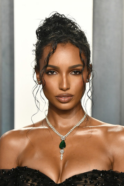 Jasmine Tookes wore her hair in a messy updo at the 2020 Vanity Fair Oscar party.