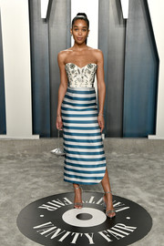 Laura Harrier sealed off her look with strappy silver sandals.