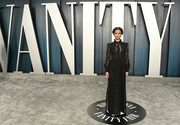 Gugu Mbatha-Raw looked romantic in a black tie-neck lace gown by Louis Vuitton at the 2020 Vanity Fair Oscar party.