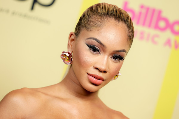 Saweetie opted for a simple slicked-back ponytail when she attended the 2021 Billboard Music Awards.