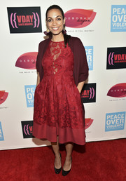 Rosario Dawson topped off her dress with a burgundy shawl-collar cardigan.
