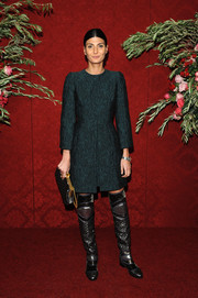 Giovanna Battaglia contrasted her classic dress with futuristic silver and black thigh-high boots.