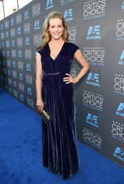 Kimberly Quinn wore a stunning blue velvet gown for the Critics' Choice Movie Awards.