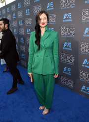 Andrea Riseborough went for a unique look for the Critics' Choice Movie Awards, opting for a bright jade pantsuit by Escada.